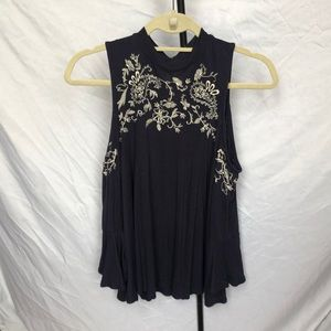 Embroidered cold shoulder flowy top